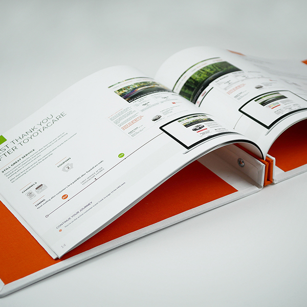 Open page spread of a communication in the large journey guide